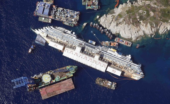 An aerial view shows the Costa Concordia as it lies on its side next to Giglio Island