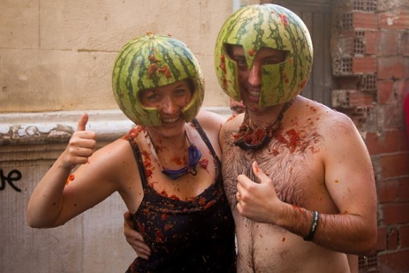 Buol, Spain.  29th August 2012 - Two people smiling at La Tomatina in Buol.  - Once again the village of Buol is visited by 40,000 people.  Since 1945, what began as a joke has become one of the best festivals of the summer.  Five trucks unload 120 tons of tomatoes over 1 hour before it is thrown at each other.